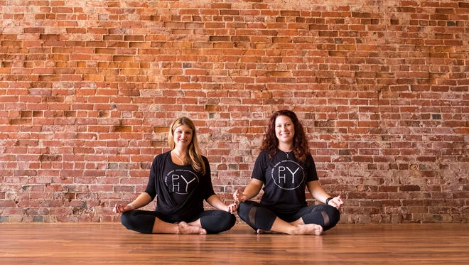 Jeni Vincent, left, and Jana Schultz are opening Port Huron Yoga at 2333 Gratiot Ave. in Port Huron. The studio will hold its grand opening the weekend of Sept. 29-Oct. 1.