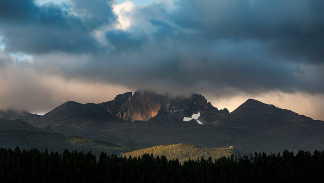 Longs Peak is obscured by early morning clouds, Wednesday, Sept. 20, 2017, at Rocky Mountain National Park, near Estes Park, Colo.