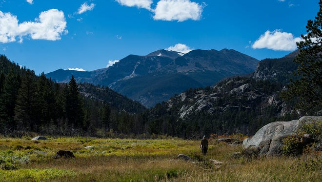 A hiker makes his way back on the Cub Lake trail loop, Wednesday, Sept. 20, 2017, at Rocky Mountain National Park, near Estes Park, Colo.