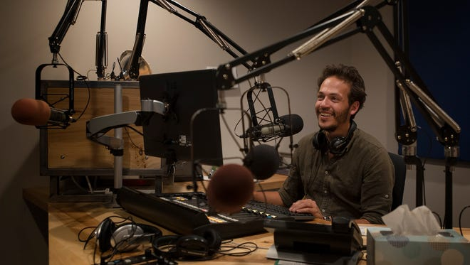 Station manager James Lopez puts together a promo on Thursday, Sept. 21, 2017, in a studio at KRFC in Fort Collins.