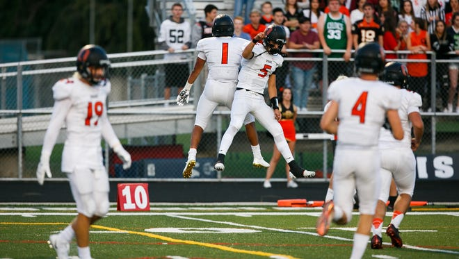 Sprague's Noah Mellen (1) and Spencer Plant (5) celebrate after another touchdown against McNary on Friday, Sept. 15, 2017, at McNary High School in Keizer, Ore. Sprague defeated McNary 62-6.