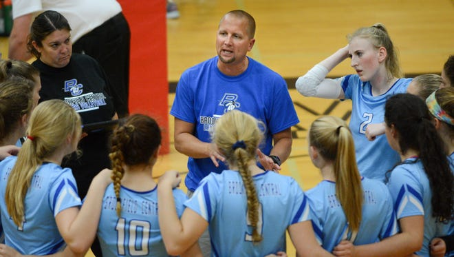 Brookfield Central coach Scott Spiess addresses his team during a timeout in the Lancers' semifinal match against Oconomowoc.
