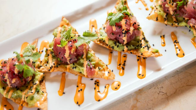The tuna poke features wontons topped with ahi tuna and smashed avocado, served at Burger Study, an upscale restaurant and bar attached to Circle Centre Mall, Indianapolis, seen Friday, Sept. 22, 2017.