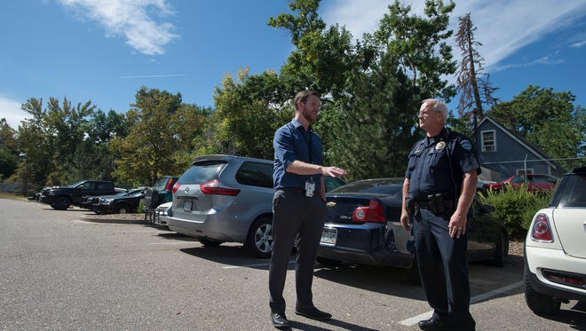 Summitstone Health Partners clinician Jesse Boyd, left, recounts a recent situation where he accompanied Loveland's SWAT team to a call while Crisis Intervention Team Commander Tim Brown looks on.