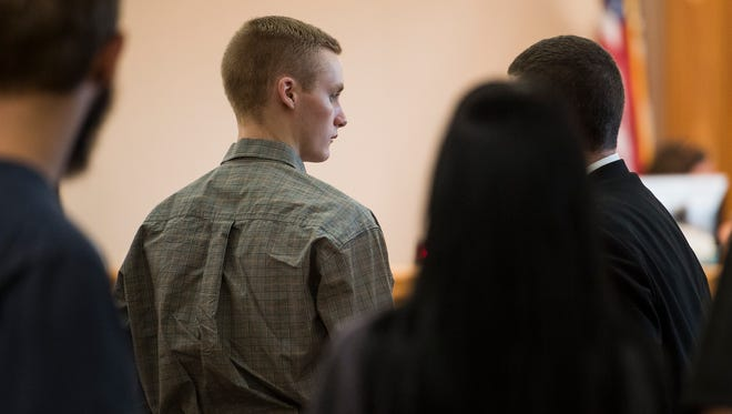 Tanner Flores stands after the jury leaves the court for an overnight recess, Tuesday, Sept. 26, 2017, during the first day of Flores' trial at the Larimer County Justice Center in Fort Collins, Colo.