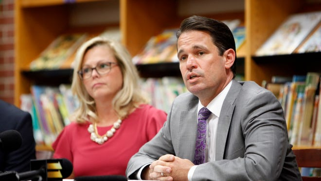 Acting JCPS superintendent Marty Pollio, center, addresses questions from the media along with Angela Hosch, principal of Portland Elementary School, left, and Teri Reed, principal of Jefferson County Traditional Middle School, during a press conference held at Portland Elementary School. Sept. 27, 2017