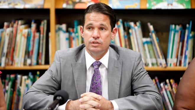 Acting JCPS superintendent Marty Pollio addresses questions from the media during a press conference held at Portland Elementary School. Sept. 27, 2017