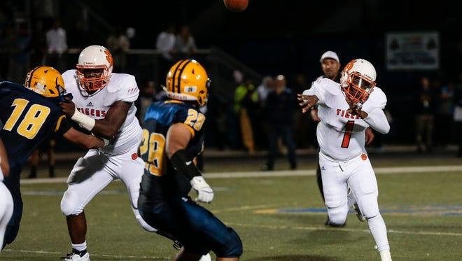 Belleville quarterback  Christian Dhue-Reid (10) makes a pass during Belleville's 35-7 win over Fordson on Friday, Sept. 29, 2017, at Fordson.