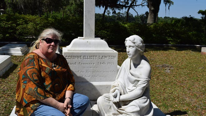 Patricia Mesmer communes with the ghost at Bonaventure Cemetery.