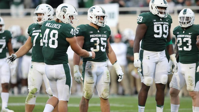 Michigan State's Joe Bachie calls the defense during the third quarter of MSU's 17-10 win over Iowa on Saturday, Sept. 30, 2017, in East Lansing.