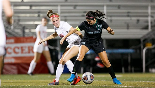South Salem's Jade Venegas (4) and West Salem's Valeria Castro Arciga (10) compete for control of the ball on Thursday, Sept. 28, 2017, at South Salem High School.