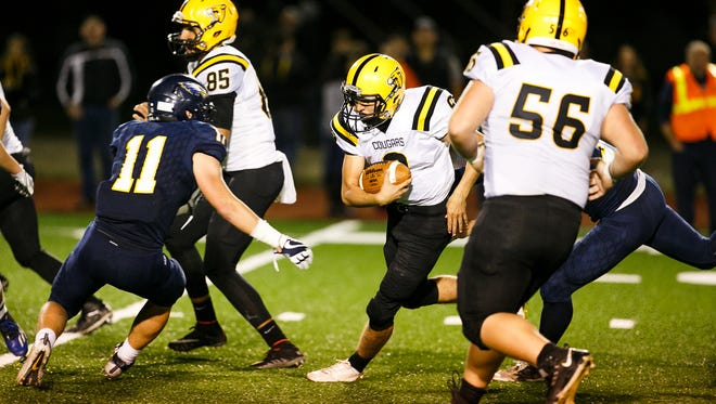 Cascade's Quinn Legner (8) carries the ball in a game against Stayton on Friday, Sept. 29, 2017, at Stayton High School. Cascade won the matchup 58-14.