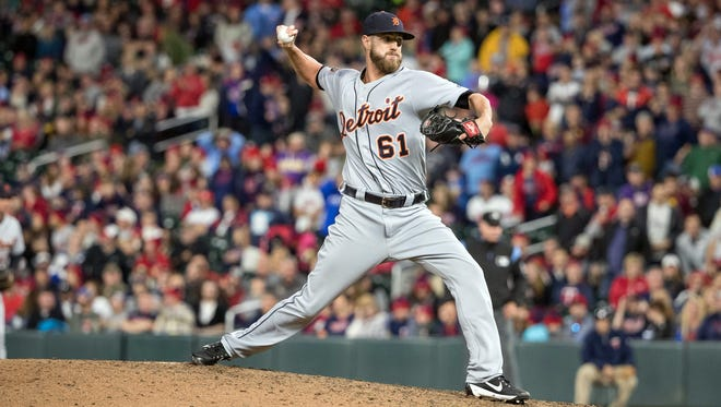 Tigers relief pitcher Shane Greene (61) delivers a pitch during the ninth inning of the Tigers' 3-2 win over the Twins on Saturday, Sept. 30, 2017, in Minneapolis.