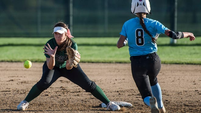 Fossil Ridge High School senior shortstop Rheanna Will catches Mountain Range High School junior Emilee Younger on a steel attempt Tuesday at Fossil Ridge High School .