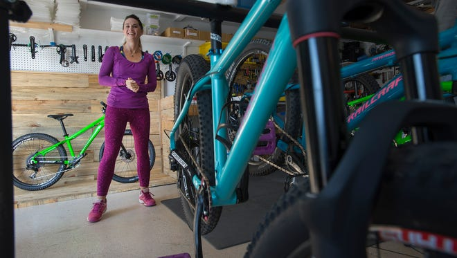 Trailcraft Cycles co-founder Ginger Rosenbauer discusses the beginning of the company run from her and her husband's home, Wednesday, Oct. 4, 2017, at Ginger and Brett Rosenbauer's home and headquarters of Trailcraft Cycles in Fort Collins, Colo.