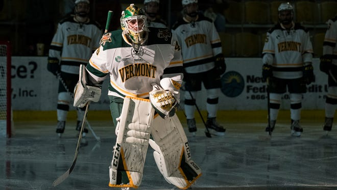 Vermont goalie Stefanos Lekkas (40) is introduced during the men's hockey game between the Colorado College Tigers and the Vermont Catamounts at Gutterson Field House on Friday night October 6, 2017 in Burlington.