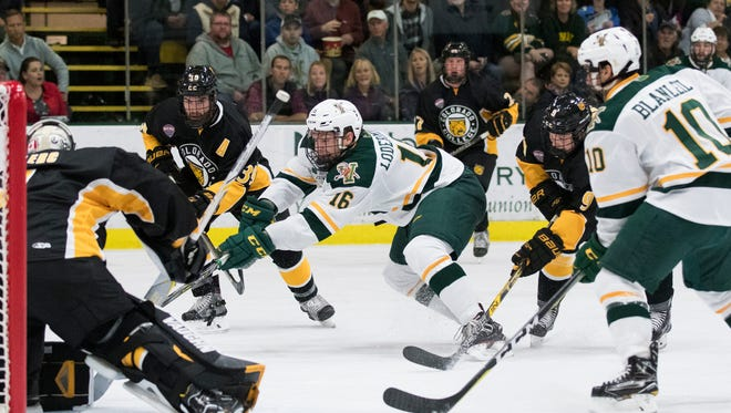 Vermont forward Derek Lodermeier (16) battles for the puck in front of the net during the men's hockey game between the Colorado College Tigers and the Vermont Catamounts at Gutterson Field House last month.