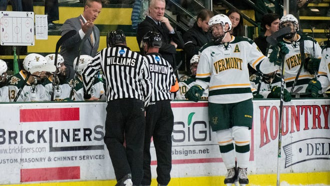 Vermont head coach Kevin Sneddon talks to the referee during the men's hockey game between the Colorado College Tigers and the Vermont Catamounts at Gutterson Field House on Friday night October 6, 2017 in Burlington.