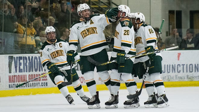 The Catamounts celebrate a goal during the men's hockey game between the Colorado College Tigers and the Vermont Catamounts at Gutterson Field House on Friday night October 6, 2017 in Burlington.