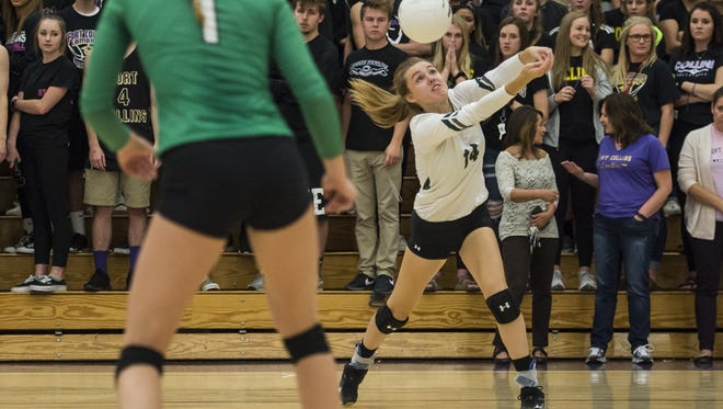 Fossil Ridge High School junior Courtney Dix digs during last week's win over Fort Collins. The Sabercats beat Fairview on Monday.