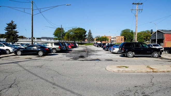A new plan downtown will offer business owners and employees and loft residents permits for certain parking areas.