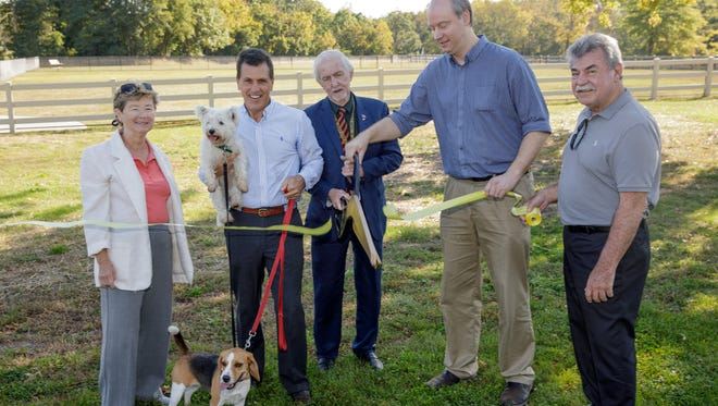 Officials from the Somerset County Board of Chosen Freeholders, Montgomery Township and the Somerset County Park Commission recently gathered at Skillman Park in the township to officially open the Skillman Park Dog Park.