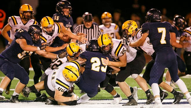 Stayton's James Bridge (25) is taken down by Cascade defense on Friday, Sept. 29, 2017, at Stayton High School. Cascade won the matchup 58-14.