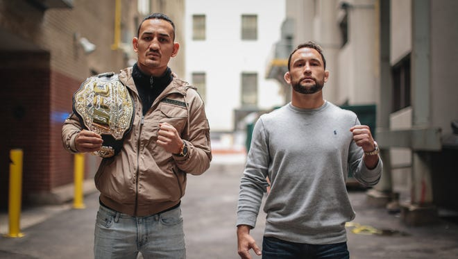 UFC featherweight champion Max Holloway (left) and Frankie Edgar pose in downtown Detroit on Thursday October 12, 2017. The two will face during UFC 218 at Little Caesars Arena in Detroit on Dec. 2.