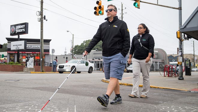 Bianca Gerena, right, follows behind Leo Leighton during a orientation and mobility lesson in Broad Ripple, Indianapolis, Wednesday, Oct. 11, 2017. Gerena is an orientation and mobility specialist at Bosma Enterprises. Leighton, who has partial vision loss due to ocular histoplasmosis syndrome, is learning to navigate with a white cane. In 1964, President Lyndon B. Johnson declared October 15 national White Cane Safety Day.