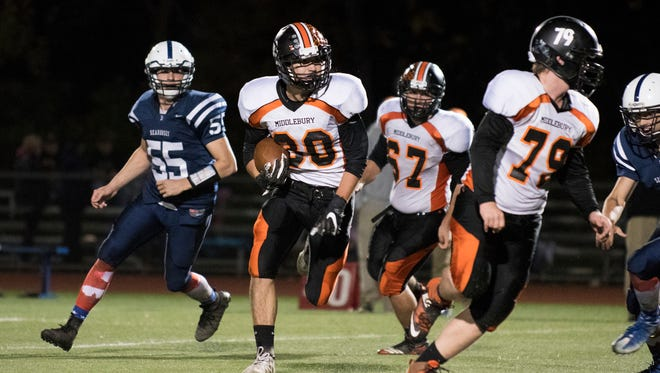 Middlebury's Lane Sheldrick (30) runs with the ball during the high school football game between the Middlebury Tigers and the Burlington Seahorses at Buck Hard field on Friday night.