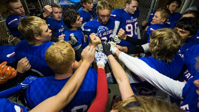 The Briggsdale football team meets before the second half of a homecoming 6-man football game between the Briggsdale Falcons and the Fleming High School Wildcats played Friday, Sept. 6, 2017, at Briggsdale High School in Briggsdale, Colo.