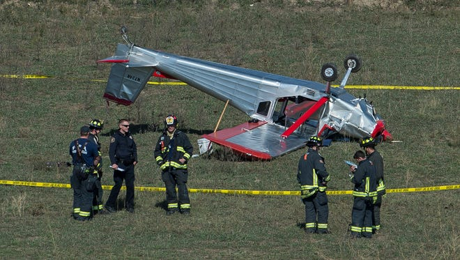 A small airplane sits upside down while firefighters work the scene, Friday, Oct. 13, 2017, just East of Highway 287 and North Overland Trail in Larimer County.