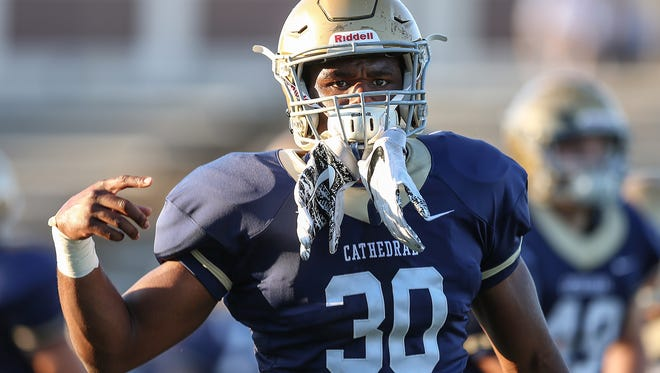 Cathedral Fighting Irish running back Markese Stepp (30) warms up before taking on the Center Grove Trojans at Arsenal Technical High School, Indianapolis, Friday, Oct. 13, 2017. Cathedral won, 21-14.