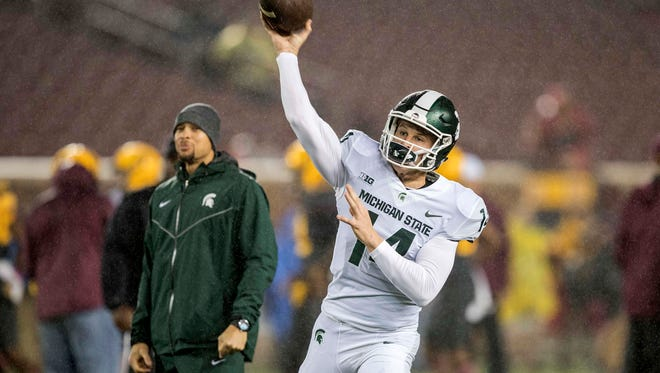 Oct 14, 2017; Minneapolis, MN, USA; Michigan State Spartans quarterback Brian Lewerke (14) drops back for a pass during pregame before a game against the Minnesota Golden Gophers at TCF Bank Stadium. Mandatory Credit: Jesse Johnson-USA TODAY Sports