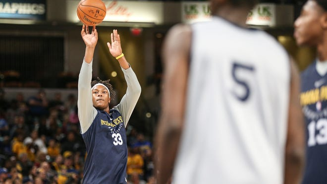 Indiana Pacers forward Myles Turner (33) warms up for a scrimmage game during the Indiana Pacers FanJam at Banker's Life Fieldhouse, Indianapolis, Sunday, Oct. 15, 2017.