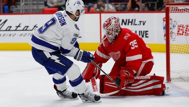 Lightning center Tyler Johnson scores against Red Wings goalie Jimmy Howard in the first period of the Wings' 3-2 loss on Monday, Oct. 16, 2017, at Little Caesars Arena.