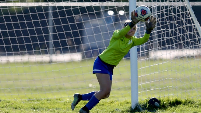Western Mennonite's Annika Hess (21) makes a save in the recent Western Mennonite vs. Blanchet girls soccer game at Blanchet Catholic School. Western Mennonite won the game 2-0.