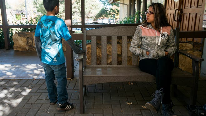 Ingrid Encalada, a Denver woman and mother of two ordered to deport to her native country of Peru, speaks with her older son Bryant at the church where she is seeking sanctuary, Foothills Unitarian Church in Fort Collins, on Tuesday.