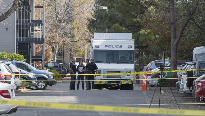 Investigators work the scene of an early-morning homicide Thursday in the 700 block of City Park Avenue in Fort Collins.