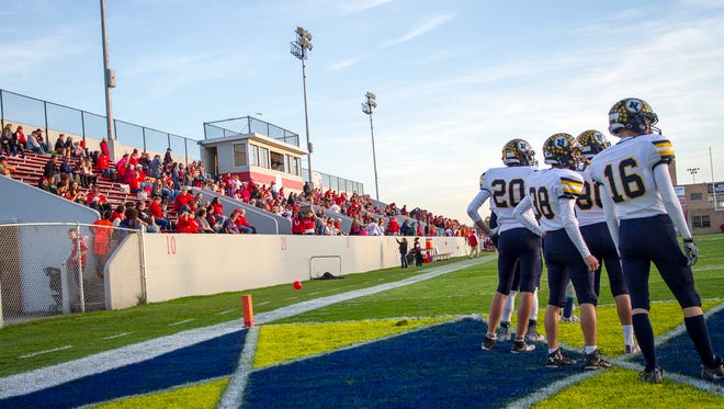 The Port Huron Northern Huskies warm up before the Crosstown Showdown football game Oct. 20.