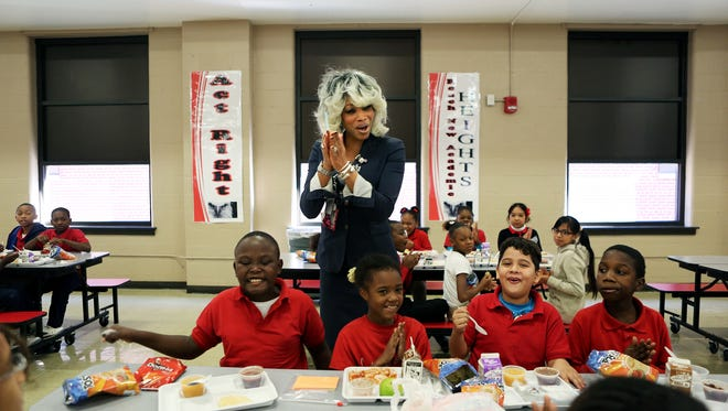 "December 4, 2015 - Shelby County School's Dr. Sharon Griffin greets students lunching at Treadwell Elementary School Friday morning. Griffin, who won administrator of the year for Tennessee, is the regional superintendent for the iZone schools. ""I miss being a principal and a teacher,"" states Griffin. ""I try to make sure that I visit schools on a weekly basis so that I don't ever forget when I'm at the district office making a decision what it's like, first of all, to be a student, to be a teacher, and to be a leader in a school. Every single decision that we make is driven with those three components in mind."" (Yalonda M. James/The Commercial Appeal)"