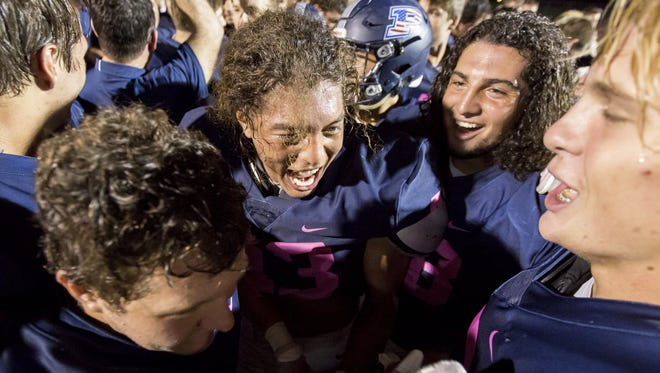 Perry celebrates after defeating the Hamilton Huskies 65-63 at Perry High School on Saturday, October 21, 2017 in Gilbert, Arizona.