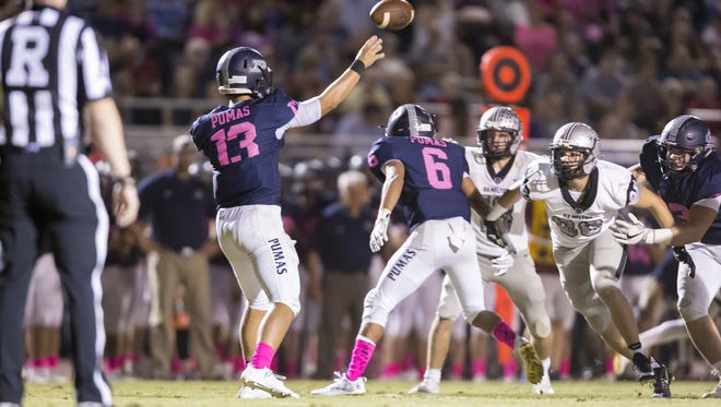 Quarterback Brock Purdy (13) of the Perry Pumas throws a pass in the first half of the high school football game between the Perry Pumas and the Hamilton Huskies at Perry High School on Friday, October 20, 2017 in Gilbert, Arizona.