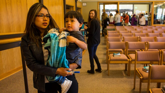 Peruvian sanctuary seeker Ingrid Encalada Latorre holds her one-year-old son Anibal after a service where she was introduced to the congregants, Sunday morning, Oct. 22, 2017, during a worship service at Foothills Unitarian Church in Fort Collins, Colo.