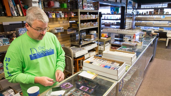 James McWhorter, owner of The Dugout, a sports memorabilia and game card store that has regular games on a series of tables in the west Indy store, Indianapolis, Friday, Oct. 20, 2017. The store is celebrating its 20th year.
