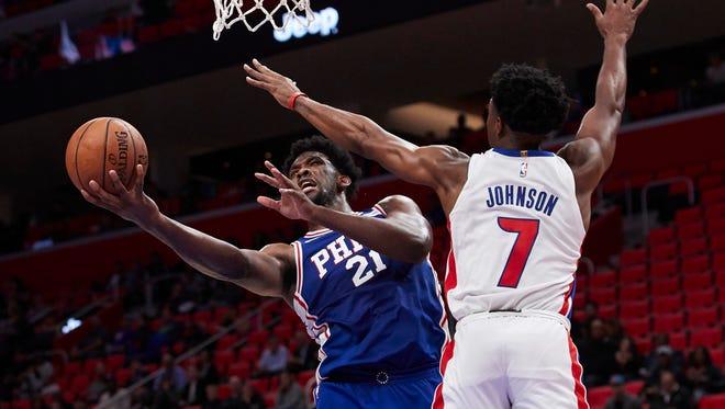 Philadelphia 76ers guard Ben Simmons (25) shoots on Detroit Pistons forward Stanley Johnson (7) in the second half at Little Caesars Arena.