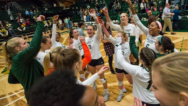 The CSU volleyball team celebrates after winning a game against rival Wyoming on Tuesday, Oct. 24, 2017, at Moby Arena in Fort Collins.