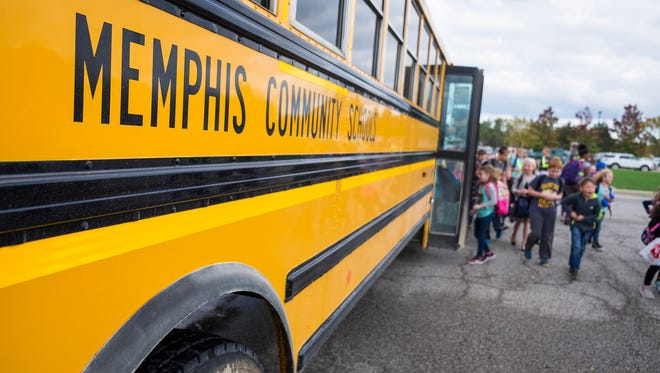 Students board a school bus at Memphis Elementary School Oct. 24. Several times this year, some students have had to stay an extra hour at Memphis Community Schools due to a shortage of bus drivers.