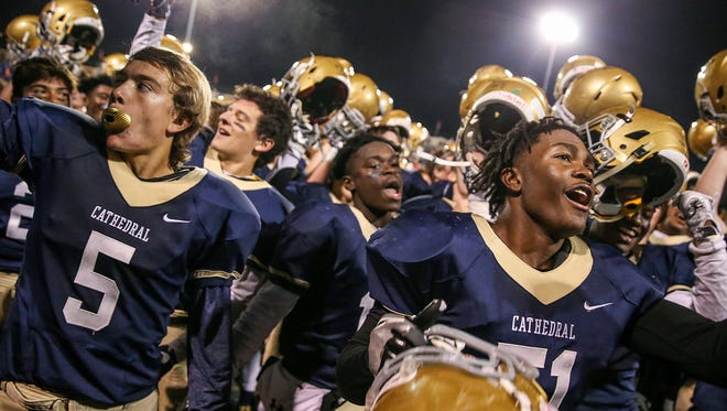 The Cathedral Fighting Irish celebrate by singing toward the crowd after defeating the Roncalli Rebels, 28-23, in IHSAA sectionals at Arsenal Technical High School, Indianapolis, Friday, Oct. 27, 2017.