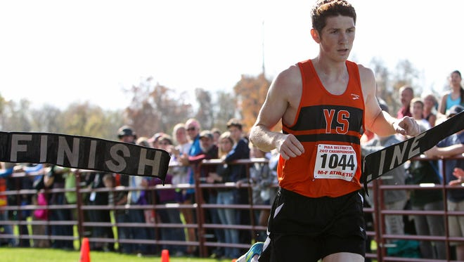 York Suburban's Bryce Ohl crosses the finish line to win the boys 2A race in the PIAA District 3 Cross Country Championships held Saturday at Big Spring High School in Newville, PA.